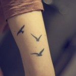 Small Birds Arm Tattoo