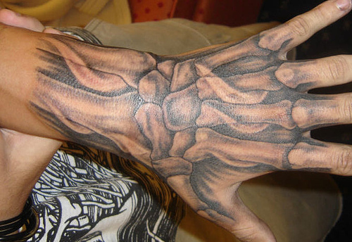 hand tattoo designs Simple Hidden Hand Tattoo