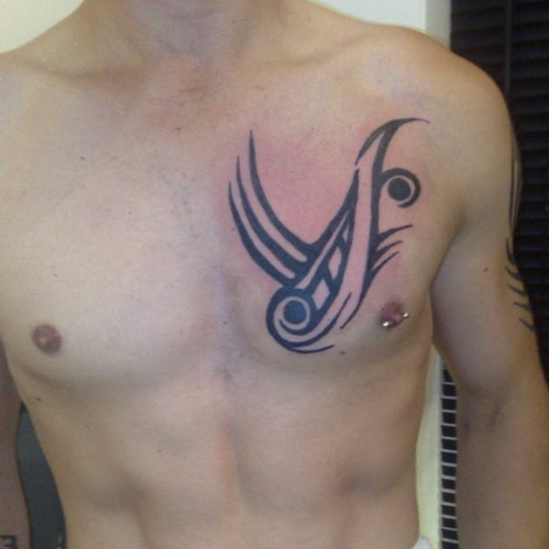 Tribal chest tattoos for men tattoo ideas mag for Small chest tattoos for guys